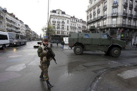 Belgian soldiers patrol in central Brussels, November 22, 2015, after security was tightened in Belgium following the fatal attacks in Paris. REUTERS/Youssef Boudlal