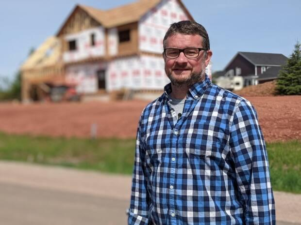 Josh Silver is taking a break from his home energy improvements for the summer to focus on new builds.  (Shane Hennessey/CBC - image credit)