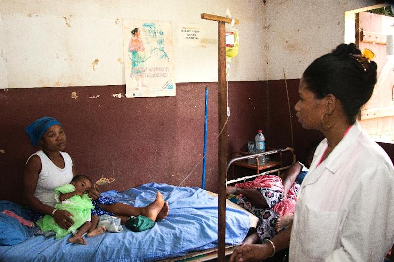 Soa Robertine's two-year-old daughter Frangeline weighs no more than a child of four months (AFP Photo/Mamyrael)