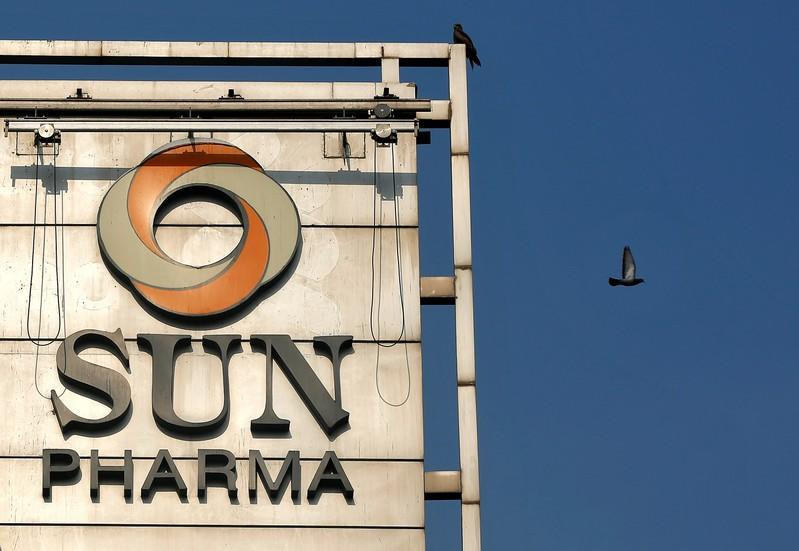 A bird flies past the logo of Sun Pharma installed on the facade of its corporate office in Mumbai