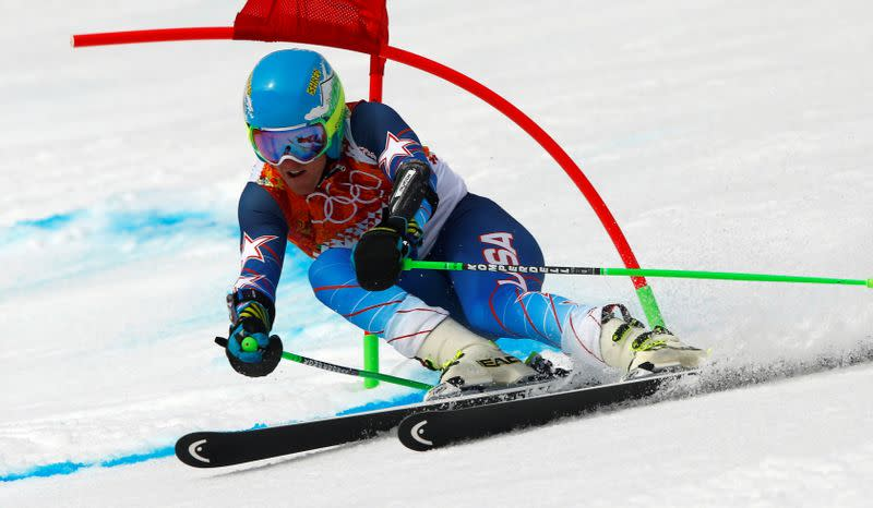 FILE PHOTO: Ligety of the U.S. clears a gate during the first run of the men's alpine skiing giant slalom event at the 2014 Sochi Winter Olympics