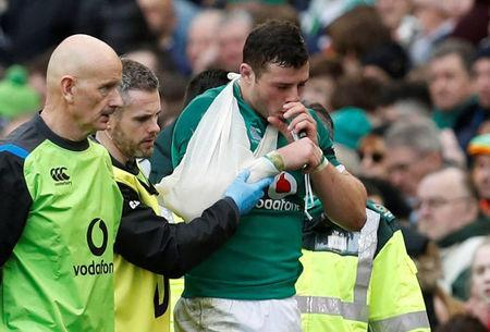 Rugby Union - Six Nations Championship - Ireland vs Italy - Aviva Stadium, Dublin, Republic of Ireland - February 10, 2018 Ireland's Robbie Henshaw walks off after sustaining an injury scoring the fifth try REUTERS/Russell Cheyne