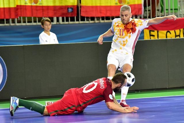 Miguel Sayago Marti from Spain (R) in action again Ricardinho from Portugal (L) during the UEFA FUTSAL EURO 2018 final game at the Arena Stozice, Ljubljana, Slovenia. EFE