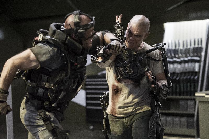 """File-This film publicity file image released by TriStar, Columbia Pictures-Sony shows Matt Damon, right, in a scene from """"Elysium."""" """"Elysium"""" topped the weekend box office with $30.5 million, according to studio estimates Sunday, enough to beat three newcomers, including the Jennifer Aniston comedy """"We're the Millers."""" (AP Photo/TriStar, Columbia Pictures - Sony, Kimberley French)"""