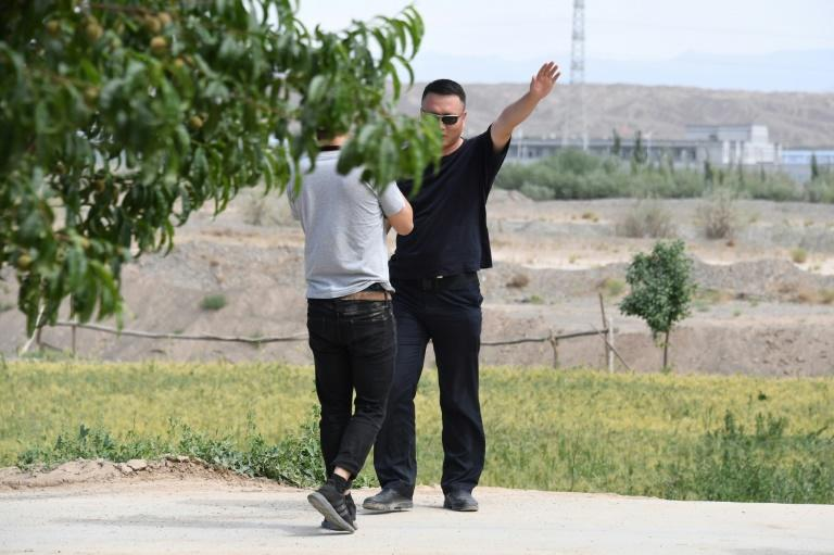 Throughout a recent visit to Xinjiang, AFP journalists were almost constantly followed by plainclothes officials, whose presence made it difficult to talk to locals without putting them at risk (AFP Photo/GREG BAKER)