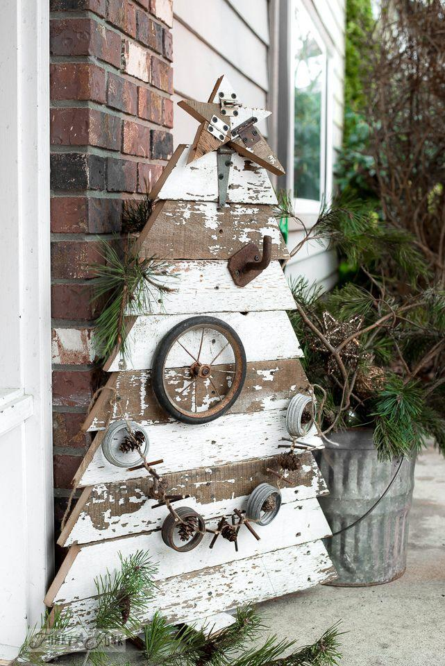 """<p>If you're a regular household DIY-er, reclaimed wood might be an abundant and affordable commodity around your house. Upcycle it into perfectly rustic Christmas porch decor, from trees to stars and more.<br></p><p><strong><em>Get the look at <a href=""""https://www.funkyjunkinteriors.net/2015/12/reclaimed-wood-christmas-tree-and-star-front-porch.html"""" rel=""""nofollow noopener"""" target=""""_blank"""" data-ylk=""""slk:Funky Junk Interiors"""" class=""""link rapid-noclick-resp"""">Funky Junk Interiors</a>. </em></strong></p>"""