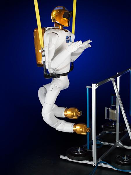 This image shows NASA's Robonaut 2 with newly developed climbing legs, designed to give the robot mobility in zero gravity. With legs, Robonaut 2 will be able to assist astronauts with both hands while keeping at least one leg anchored to the s