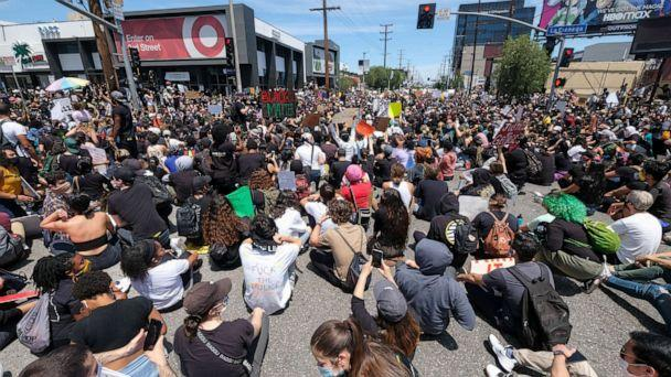 PHOTO: Peoples sit on at an intersection during a protest over the death of George Floyd in Los Angeles, May 30, 2020. (Ringo H.w. Chiu/AP)
