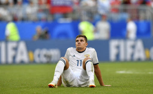 Russia's Roman Zobnin reacts following his team's 3-0 loss during the group A match between Uruguay and Russia at the 2018 soccer World Cup at the Samara Arena in Samara, Russia, Monday, June 25, 2018. (AP Photo/Martin Meissner)