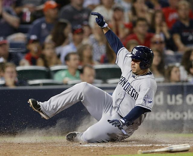 San Diego Padres Rene Rivera scores on a ground ball by Jeff Gyorko in the seventh inning of a baseball game in Atlanta, Friday, Sept. 13, 2013. (AP Photo/John Bazemore)