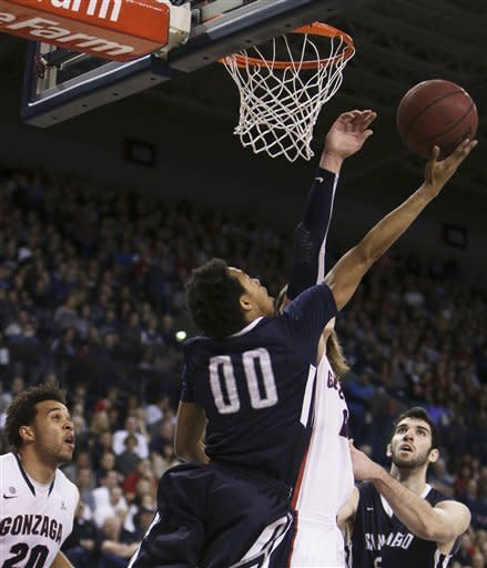 San Diego's Christopher Anderson (00) attempts a layup during the first half of an NCAA basketball game against Gonzaga in Spokane, Wash., on Saturday, Feb. 23, 2013. (AP Photo/Young Kwak)