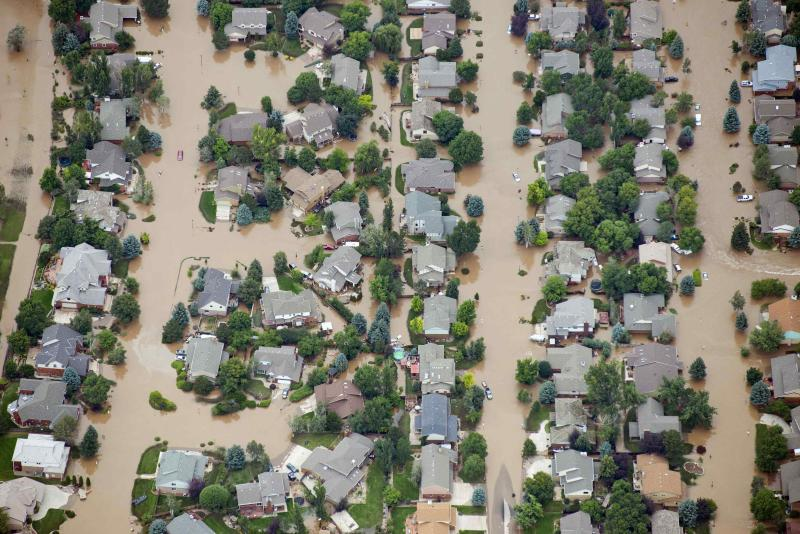 An aerial view of suburban streets flooded in Longmont