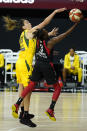 Las Vegas Aces guard Danielle Robinson (3) shoots as she is guarded by Seattle Storm forward Breanna Stewart (30) during the first half of Game 1 of basketball's WNBA Finals Friday, Oct. 2, 2020, in Bradenton, Fla. (AP Photo/Chris O'Meara)