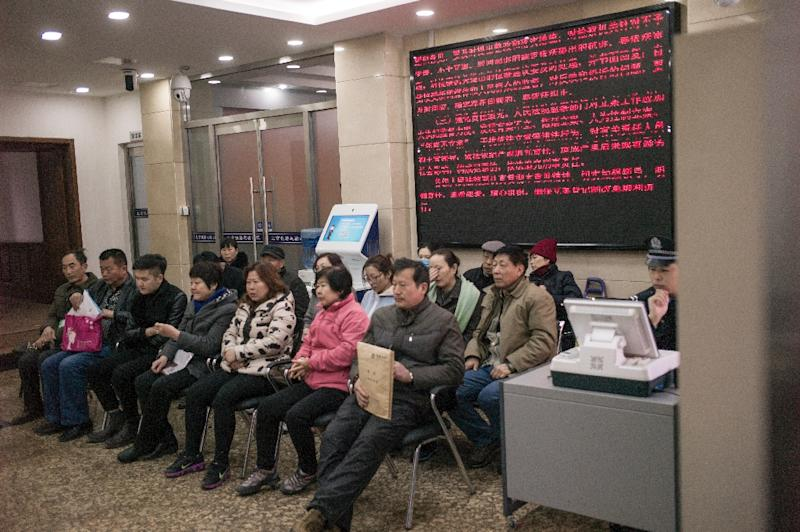 Relatives of Chinese passengers aboard missing Malaysia Airlines flight MH370 wait inside the Beijing Rail Transportation Court in Beijing on March 7, 2016 (AFP Photo/Fred Dufour)