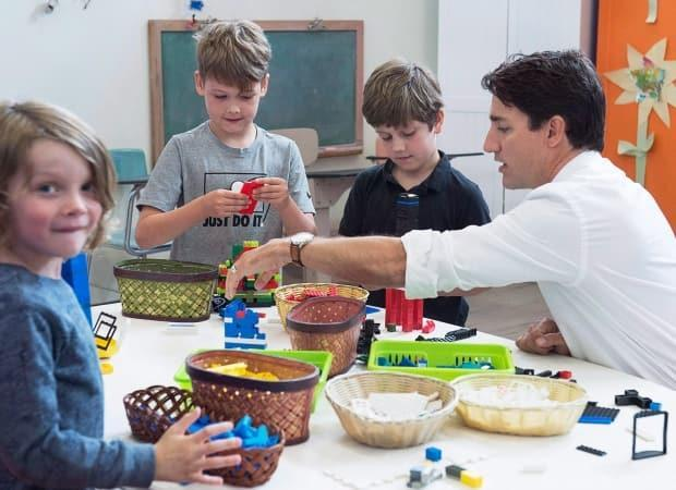 Prime Minister Justin Trudeau plays with children as he visits Wee College daycare and early learning centre in Moncton, N.B. on Wednesday, Aug. 30, 2017. (Andrew Vaughan/Canadian Press - image credit)