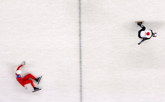 "Short Track Speed Skating Events - Pyeongchang 2018 Winter Olympics - Men's 500 m Competition - Gangneung Ice Arena - Gangneung, South Korea - February 20, 2018. Keita Watanabe of Japan in action as Jong Kwang Bom of North Korea falls. REUTERS/John Sibley SEARCH ""OLYMPICS BEST"" FOR ALL PICTURES. TPX IMAGES OF THE DAY."