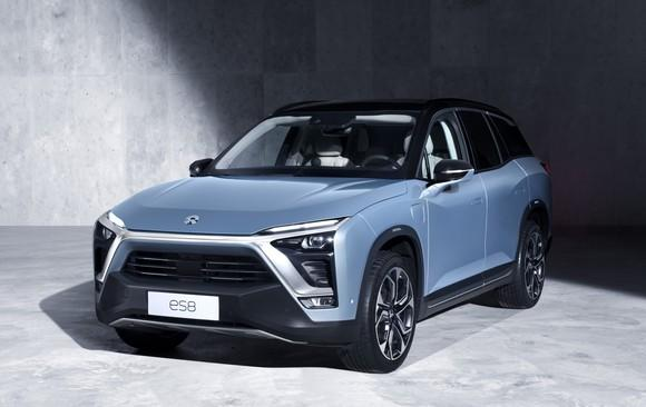 A light blue NIO ES8, a sharply styled upscale SUV.