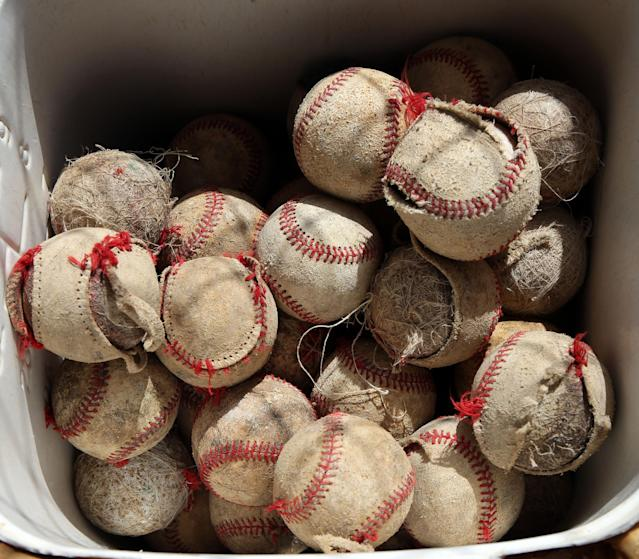 Used baseballs are seen at the baseball academy of Astin Jacobo in San Pedro de Macoris in the Dominican Republic. (Chicago Tribune/TNS)