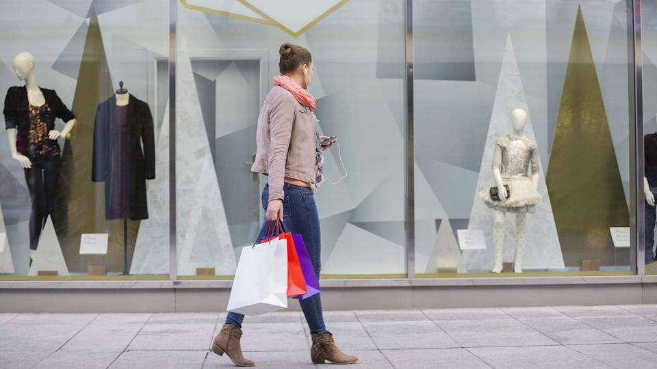 woman window shopping for luxury clothes