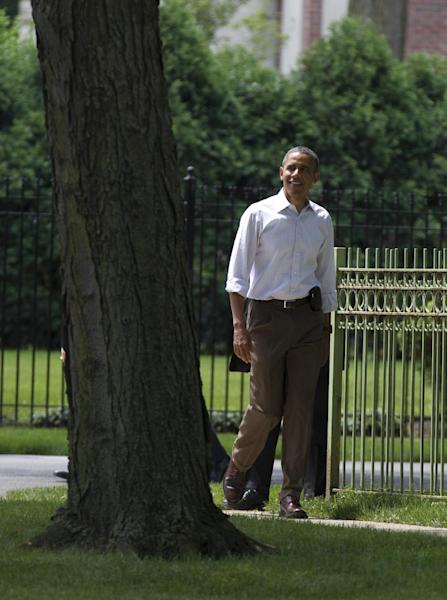 President Barack Obama walks through his Hyde Park neighborhood to his friend Marty Nesbitt's home, Saturday, June 2, 2012, in Chicago. (AP Photo/Carolyn Kaster)