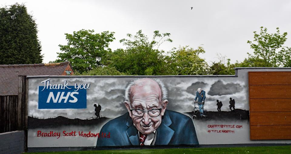 A mural that has been created to pay tribute to NHS fundraiser Captain Tom Moore outside Bradley Scott Windows in Tamworth, Staffordshire. (Photo by Jacob King/PA Images via Getty Images)