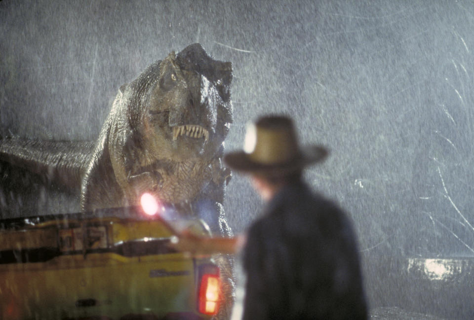 Actor Sam Neill as Dr. Alan Grant takes on a Tyrannosaurus Rex in a scene from the film 'Jurassic Park', 1993.  (Photo by Murray Close/Getty Images)