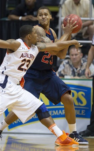Auburn guard Frankie Sullivan, left, attempts to knock the basketball away from UTEP forward Gabriel McCulley in the first half of an NCAA college basketball game Sunday, Dec. 25, 2011, in Honolulu. (AP Photo/Eugene Tanner)