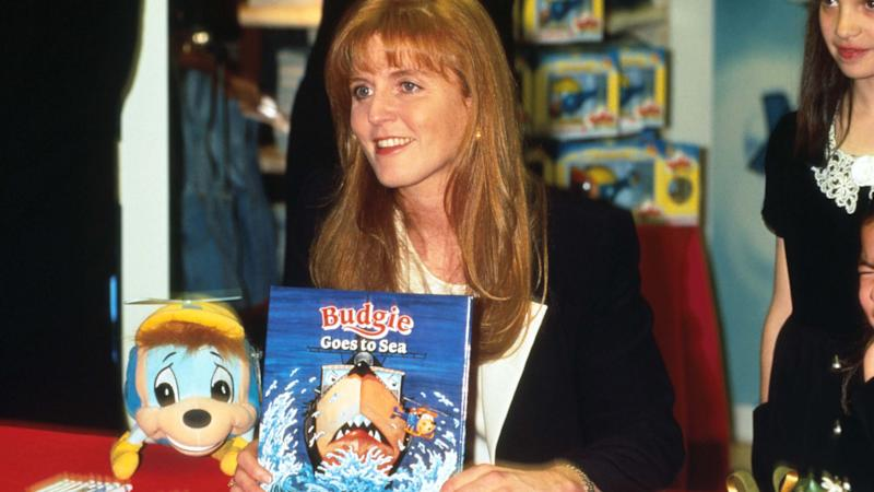"246730 02: Duchess of York Sarah Ferguson holds a copy of her book ""Budgie the Little Helicopter"" at Bloomingdale's December 2, 1995 in New York City. Ferguson wrote a series of books about the smallest helicopter at the hanger and based them on her own experiences as a Royal Navy pilot. (Photo by Evan Agostini/Liaison)"