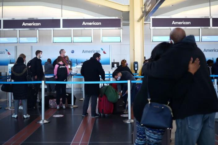 People queue at Reagan National Airport ahead of the Thanksgiving holiday in Arlington