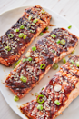 """<p>Instead of a sweet-and-smoky <a href=""""http://www.delish.com/uk/cooking/recipes/a28826259/easy-homemade-bbq-sauce-recipe/"""" rel=""""nofollow noopener"""" target=""""_blank"""" data-ylk=""""slk:barbecue sauce"""" class=""""link rapid-noclick-resp"""">barbecue sauce</a>, this easy salmon recipe calls for making a spicy Asian glaze. If you can't find fish sauce, feel free to just leave it out (though it does add a funkiness we love!).</p><p>Get the <a href=""""https://www.delish.com/uk/cooking/recipes/a29205217/best-bbq-salmon-recipe/"""" rel=""""nofollow noopener"""" target=""""_blank"""" data-ylk=""""slk:Asian BBQ Grilled Salmon"""" class=""""link rapid-noclick-resp"""">Asian BBQ Grilled Salmon</a> recipe.</p>"""