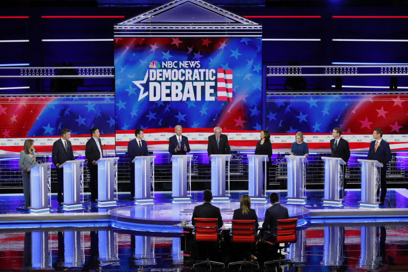 Former Vice President Joe Biden speaks as other Democratic presidential candidates listen during the second night of the first Democratic debate in Miami in June. (Photo: Mike Segar/Reuters)