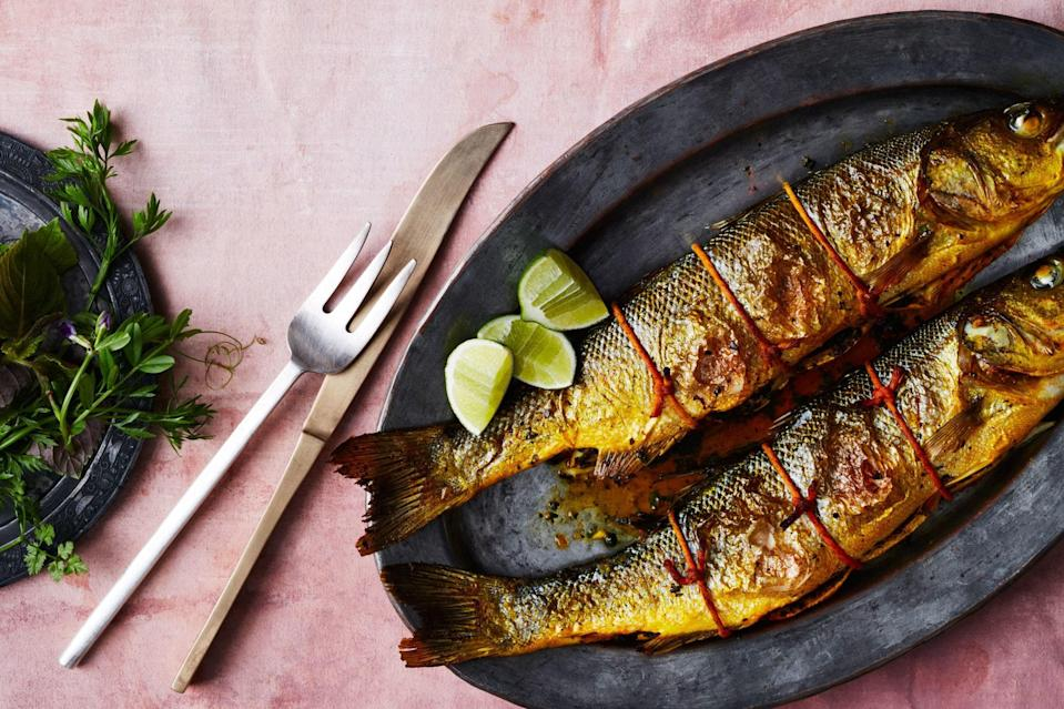 """Saffron and a flurry of herbs give this easy fish dish vibrant flavor. Start to finish, it'll only take you about half an hour to prepare. <a href=""""https://www.epicurious.com/recipes/food/views/roasted-black-bass-with-orange-flower-water?mbid=synd_yahoo_rss"""" rel=""""nofollow noopener"""" target=""""_blank"""" data-ylk=""""slk:See recipe."""" class=""""link rapid-noclick-resp"""">See recipe.</a>"""