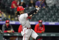 Cincinnati Reds' Jonathan India follows through on a three-run home run off Colorado Rockies relief pitcher Mychal Givens during the eighth inning of a baseball game Thursday, May 13, 2021, in Denver. (AP Photo/David Zalubowski)