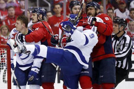 May 21, 2018; Washington, DC, USA; Washington Capitals left wing Alex Ovechkin (8) grabs onto Tampa Bay Lightning center Tyler Johnson (9) in front of the net as right wing Tom Wilson (43) looks on during the second period in game six of the Eastern Conference Final in the 2018 Stanley Cup Playoffs at Capital One Arena. Mandatory Credit: Geoff Burke-USA TODAY Sports