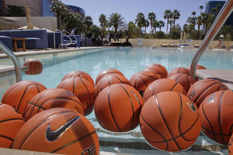 Basketballs float in a pool at the MGM Grand Casino and Hotel during a news conference announcing that the Pac-12 basketball tournament will be played in Las Vegas, Tuesday, March 13, 2012, in Las Vegas. (AP Photo/Julie Jacobson)