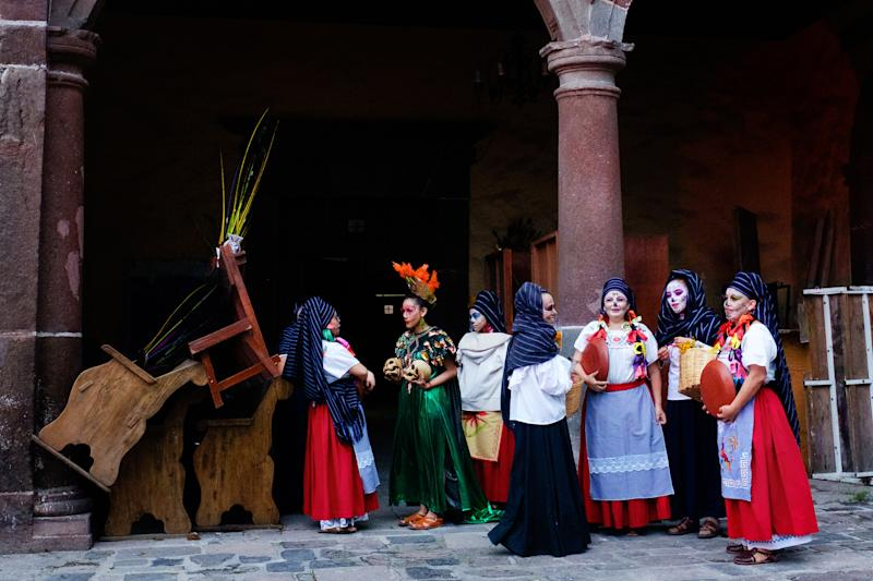Dancers wait offstage during a traditional performance.
