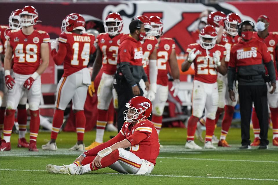 Kansas City Chiefs quarterback Patrick Mahomes (15) sits on the turf during the second half of the NFL Super Bowl 55 football game against the Tampa Bay Buccaneers, Sunday, Feb. 7, 2021, in Tampa, Fla. (AP Photo/David J. Phillip)