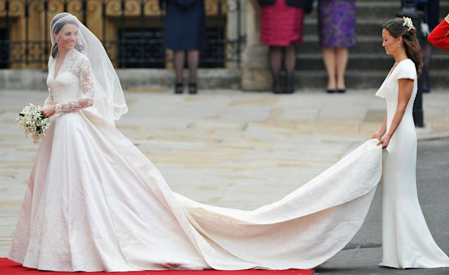 With her sister, Pippa, holding her train, Kate Middleton arrives for her wedding to Prince William at Westminster Abbey on April 29, 2011, in London.