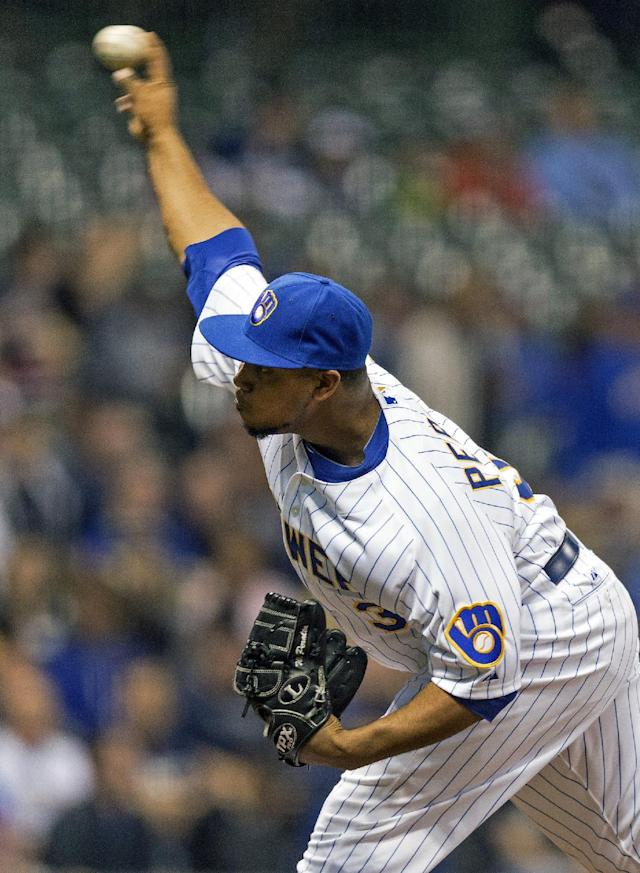 Milwaukee Brewers' Wily Peralta pitches to Pittsburgh Pirates' Starling Marte during the first inning of a baseball game on Friday, April 11, 2014, in Milwaukee. (AP Photo/Tom Lynn)