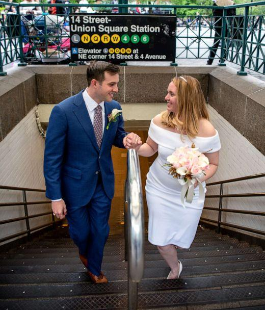 PHOTO: Newlyweds Robert Musso and Frances Denmark exit the subway in New York City following their ceremony. (Courtesy Emily Chan Photography)
