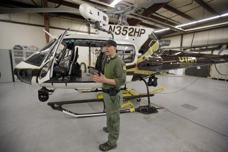 Utah Department of Public Safety's helicopter pilot Luke Bowman speaks during a news conference Monday, April 3, 2017, in Salt Lake City. During a search and rescue call for a missing kayaker, the DPS helicopter crew and a deputy from Garfield County came across a family of four who was stranded along the Escalante River. As the air crew searched the Escalante River for a missing kayaker, they noticed a group on the ground who were in obvious distress. The helicopter team landed and discovered a family who had been stranded for two days. (AP Photo/Rick Bowmer)