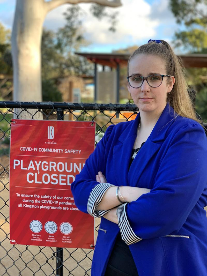 Kingston City Council mayor Georgina Oxley with a legitimate 'playground closed' sign.