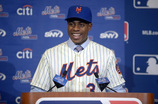 New York Mets outfielder Curtis Granderson answers a question during a news conference announcing his signing at baseball's winter meetings in Lake Buena Vista, Fla., Tuesday, Dec. 10, 2013.(AP Photo/Phelan M. Ebenhack)