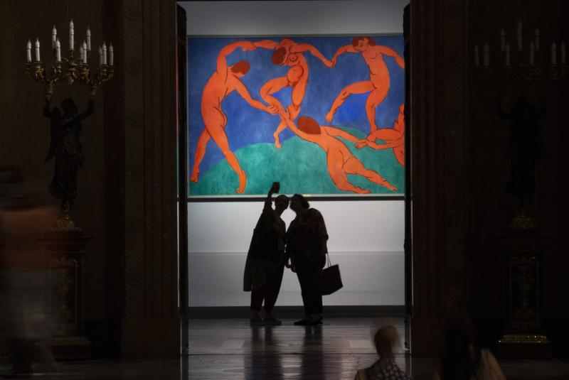 Visitors look at the Dance by Henri Matisse the collections of Sergei Shchukin, one of the most prominent collections of European Modernist art, encompassing the most important artistic trends of the late 19th and early 20th centuries at The Pushkin State Museum of Fine Arts in Moscow, Russia, Tuesday, June 18, 2019.  The exhibition will include masterpieces by Claude Monet, Pierre Auguste Renoir, Paul Cezanne, Paul Gaugin, Vincent van Gogh, Henri Matisse, Pablo Picasso, and other masters. (AP Photo/Alexander Zemlianichenko)