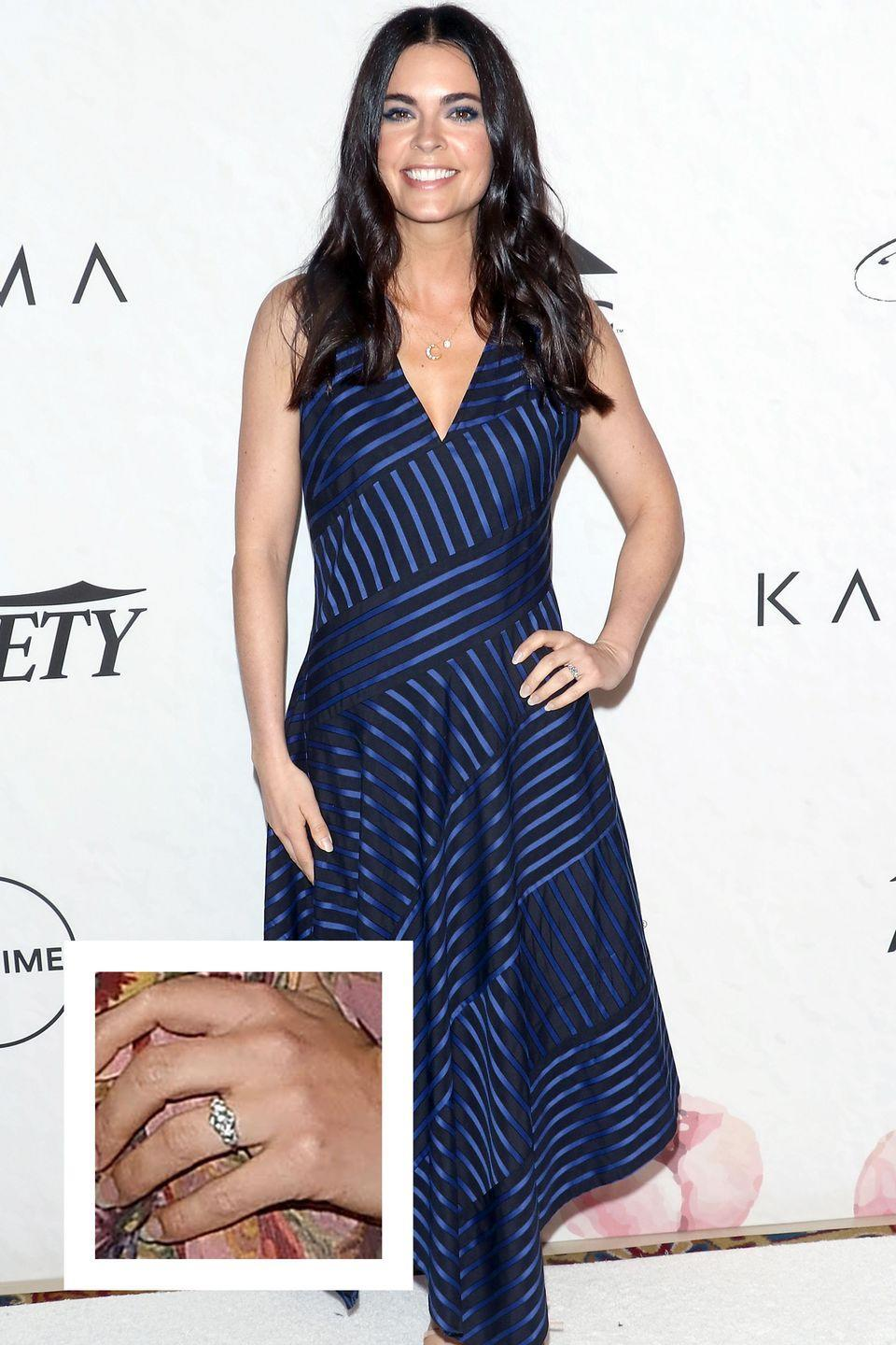 <p>The Food Network star got engaged to boyfriend Ryan Biegel in March 2018. Her dazzling diamond ring appears to be a round cut stone with diamonds on the side. </p>