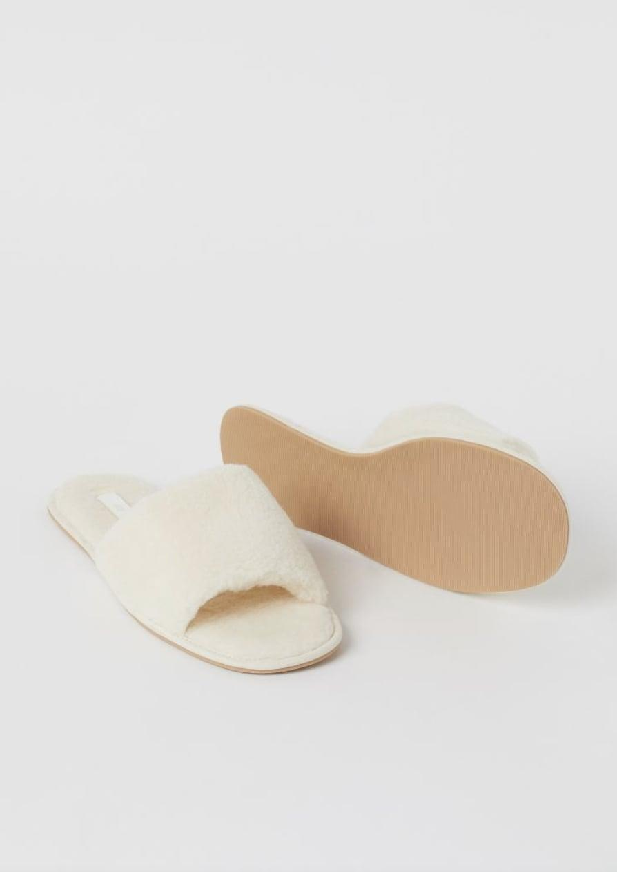 <p>You'll slide right into these soft-looking <span>Faux Shearling Slippers</span> ($18).</p>