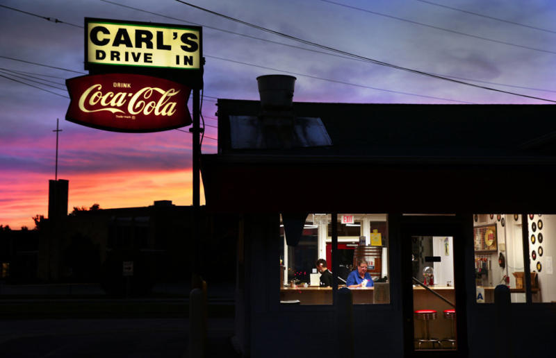 Jason Apple and Pam Martin clean up after closing for the day at Carl's Drive-In in Brentwood, Missouri, on Aug. 18, 2016. The mainstay along old Route 66, built as a 1920s gas station, was renamed in 1959 by owner Carl Meyer.<i></i>