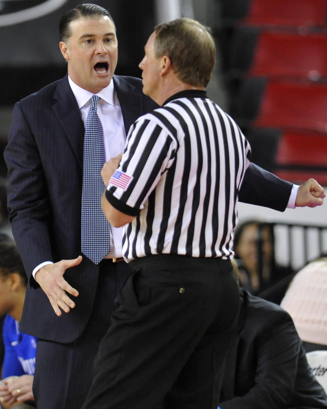 Kentucky head coach Matthew Mitchell, left, argues with a referee after a Kentucky player was called for a foul during the first half of an NCAA college basketball game against Georgia,Thursday, Jan. 30, 2014, in Athens, Ga. (AP Photo/AJ Reynolds)
