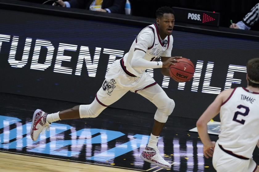Gonzaga guard Joel Ayayi drives up court during the first half of a men's Final Four NCAA college basketball tournament.