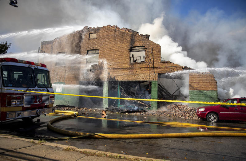 West Philadelphia Fire Department firefighters puts out a fire that broke Monday, Oct. 21, 2019, in Philadelphia. (Tyger Williams/The Philadelphia Inquirer via AP)